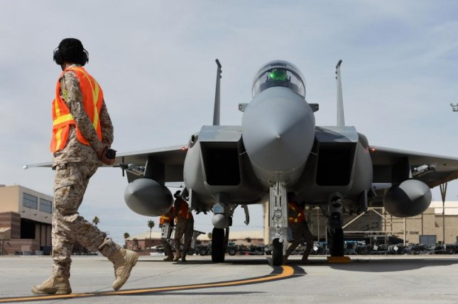 A Royal Saudi Air Force maintenance Airman walks around the F-15SA as other Airmen prepare the plane for its mission during Red Flag 19-2 at Nellis Air Force Base, in March.Advanced Electronics was awarded a $17 million contract modification to provide logistics support for the F-15SA for the Royal Saudi Air Force. Photo byIsaiah Soliz/U.S. Air Force