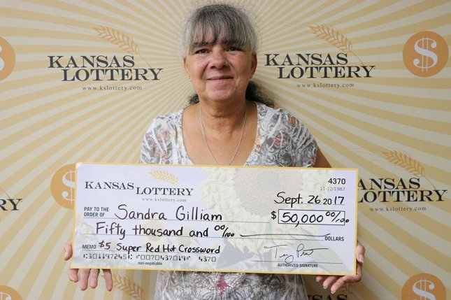 A Kansas woman won $50,000 from a $5 scratch-off lottery ticket her son gave her as a gift. Photo courtesy of the Kansas Lottery