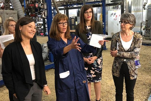 Shannon Phillips (front, left), Alberta's minister for the environment, said the new funds help the government balance economic growth with environmental stewardship. Photo courtesy of the provincial government of Alberta