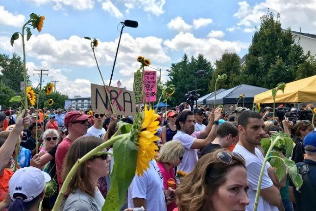 Protesters rallied at the NRA headquarters in Virginia Saturday, to honor victims of gun violence and calling for stricter gun laws. Photo courtesy @GiffordsCourage/Twitter