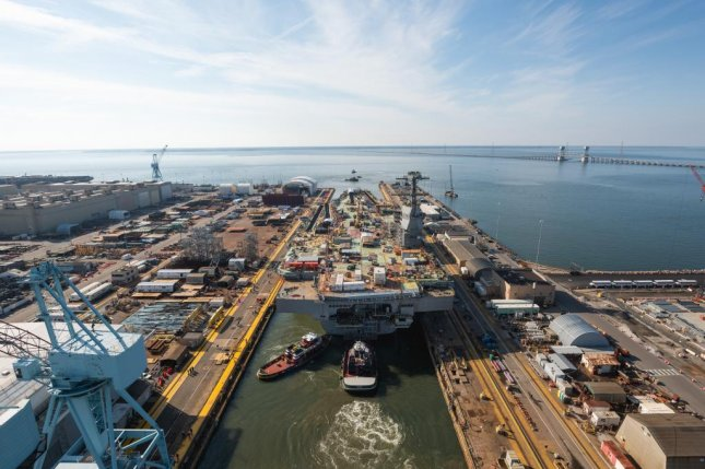 Tugboats move the aircraft carrier John F. Kennedy from Newport News Shipbuilding's Dock Dry 12 to Pier 3 on Monday, where the ship will undergo final completion and outfitting. Photo courtesy of Huntington Ingalls Industries