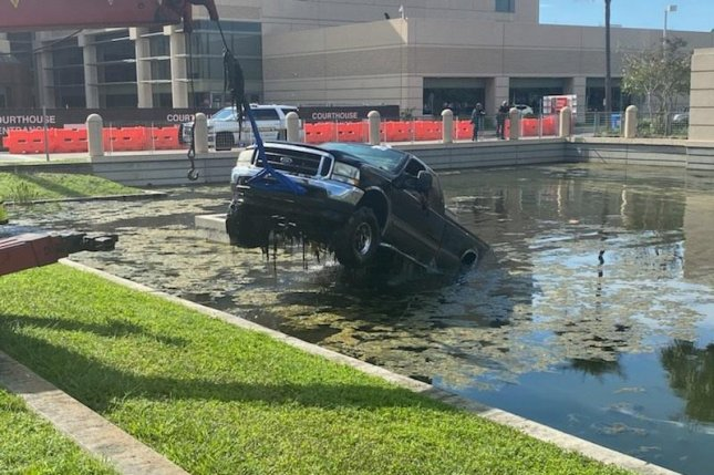 The Florida Highway Patrol said a 64-year-old Largo man attempting to park at the Pinellas Justice Center ended up driving his pickup truck directly into a retention pond. Photo courtesy of the Florida Highway Patrol