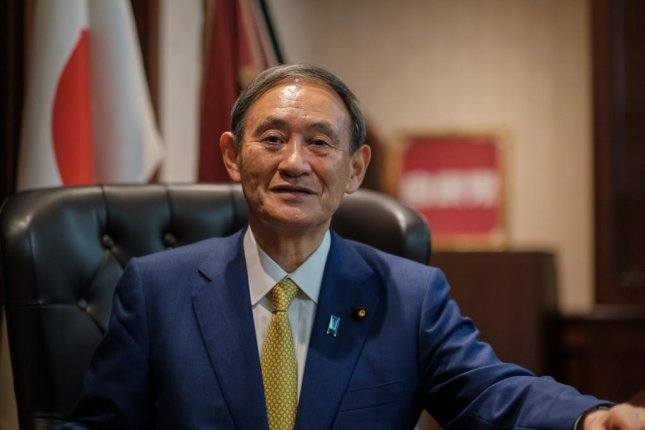 Yoshihide Suga, Japan's former chief cabinet secretary, poses Monday for a portrait following his election as Liberal Democratic Party president, in Tokyo, Japan. Photo by Nicolas Datiche/EPA-EFE/Pool