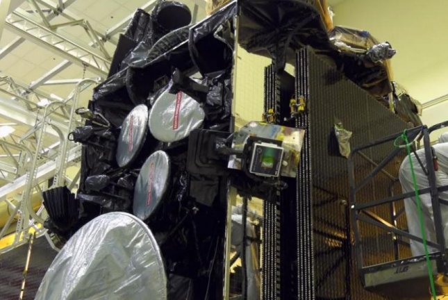 A Lockheed Martin employee prepares an Advanced Extremely High Frequency Communications satellite.  Photo courtesy of Lockheed Martin