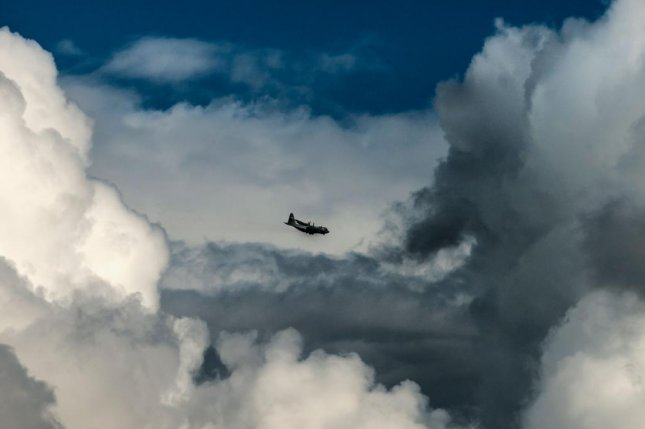 A research plane flies through tall storm clouds above the Brazilian city of Manaus, the largest city in the Amazon. Photo by PNNL
