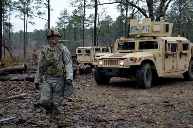 A Soldier assigned to the 3rd Brigade Combat Team, 25th Infantry Division, ground guides a M1151A1 HMMWV at Fort Polk, Louisiana, on Feb. 14, 2018. Photo by Staff Sgt. Armando R. Limon/U.S. Army