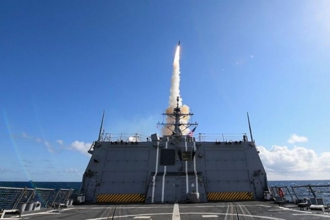 An SM-3 missile is launched from the destroyer USS Theodore Roosevelt. Photo by MCS1 Susan Dramman/U.S. Navy