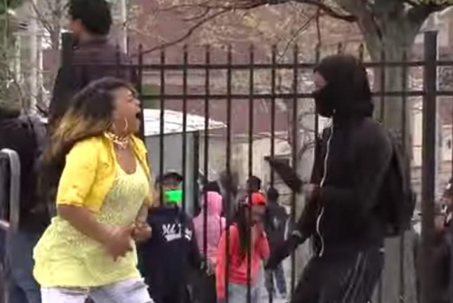 Toya Graham, captured on video reprimanding her son at the scene of Baltimore riots, said she didn't want him to be another 'Freddie Gray.' Screenshot courtesy of WJZ