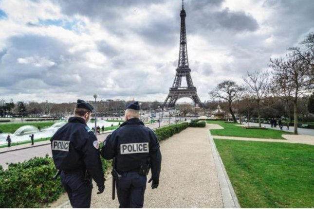 French officers police the grounds surrounding the Eiffel Tower in Paris, France. On Thursday, a Paris prosecutor said five suspects were arrested in a foiled terror plot planned in several loations on Dec. 1 in France. File photo by BlackMac/Shutterstock