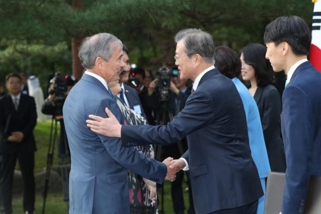 U.S. Ambassador to South Korea Harry Harris (L) is at the center of controversy in Seoul following remarks regarding South Korean President Moon Jae-in (R). File Photo by Yonhap/EPA-EFE
