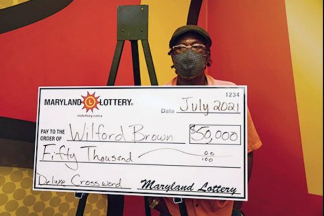 Wilford Brown of Calvert County, Md., used some of the $100 he won from a scratch-off lottery ticket to buy another ticket that earned him a $50,000 jackpot. Photo courtesy of the Maryland Lottery