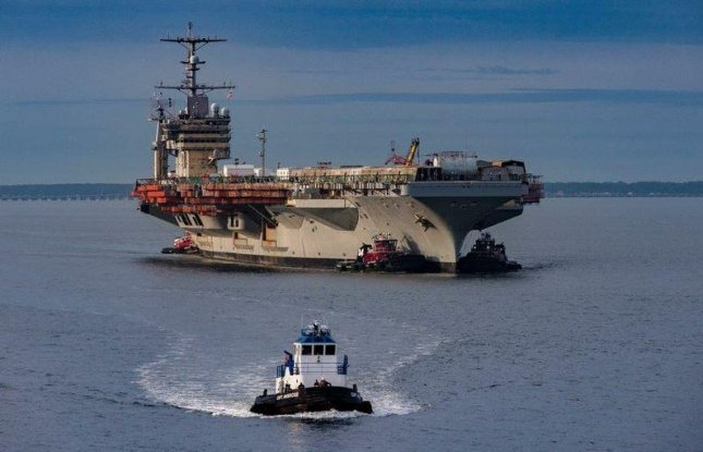 The aircraft carrier USS George Washington arrived in Newport News, Va., in August 2017 for a four-year overhaul. Work reached thje halfway point of completion on Tuesday. Photo courtesy of Huntington Ingalls Industries