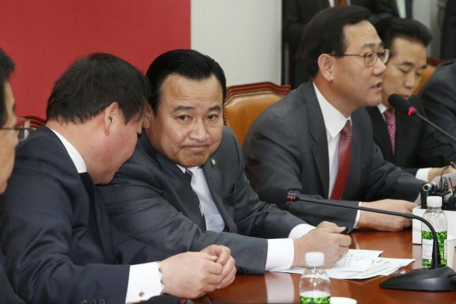 South Korean Prime Minister Lee Wan-koo, center, resigned last week. South Korean President Park Geun-hye has accepted his decision after allegations surfaced he had received illegal donations from a businessman in 2013. Photo by Yonhap.