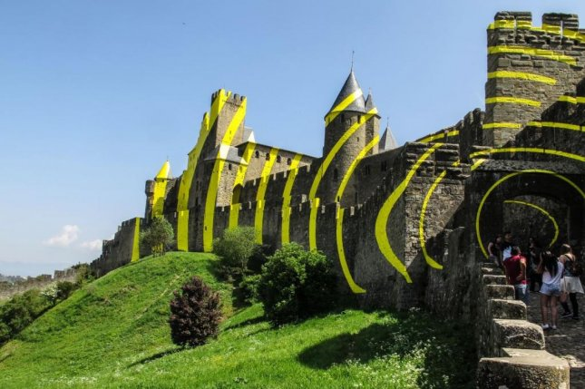 locals angered over artwork covering medieval french fortress. Black Bedroom Furniture Sets. Home Design Ideas