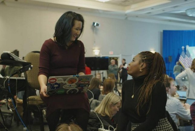 Senior national correspondent for CNN Kyung Lah (L) speaks with CNN politics producer Jasmine Wright. Both journalists will be featured in upcoming HBO Max documentary film, On the Trail: Inside the 2020 Primaries. Image courtesy of HBO Max