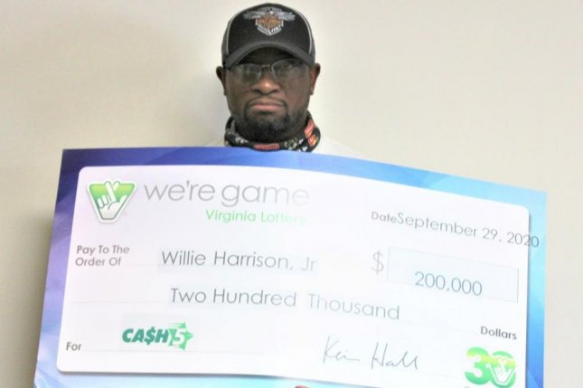 Willie Harrison, of Forest, Va., collected a $200,000 jackpot from a Cash 5 drawing a little over a year after he won a $100,000 prize. Photo courtesy of the Virginia Lottery