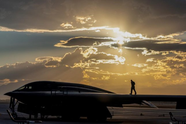 An Airman assigned to the 509th Bomb Wing at Whiteman Air Force Base, Mo., walks across a B-2 Spirit at Nellis Air Force Base in Nevada last Friday. Photo by Dylan Murakami/U.S. Air Force