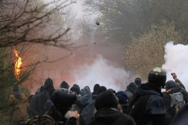 French police moved on Monday to evict demonstrators encamped on land at Notre-Dame-des-Landes, France, the site of abandoned plans for an airport. Police destroyed the encampment, and demonstrators threw rocks and homemade rockets in response. Photo by Eddy Lemaistre/EPA-EFE