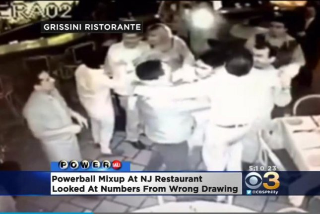 Workers at a New Jersey restaurant celebrate upon mistakenly believing they won the Powerball lottery drawing. CBS Philly video screenshot