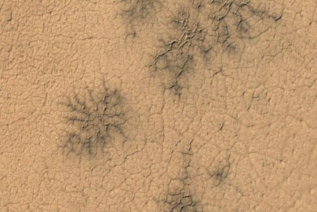 Citizen scientists helped researchers locate geologic formations called 'spiders' in unexpected locations on Mars' surface. Photo by University of Oxford