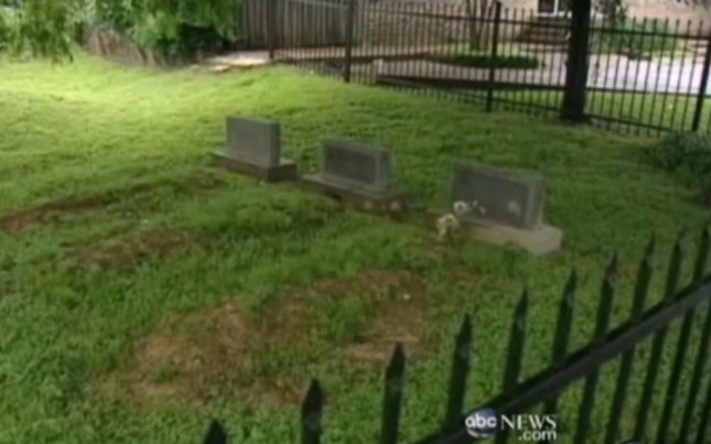 A scarecrow graveyard in downtown Houston, built to keep littering and loitering at bay, accidentally contains tombstones originally made for real people. (Screenshot via ABC News)