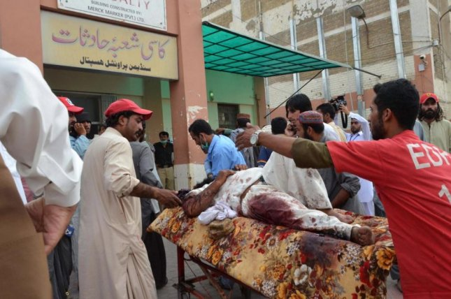 Victims of an explosion at a political rally in Dringarh, Paklistan, are taken to a hospital in nearby Quetta on Friday. At least 70 died in two separate explosions at campaign rallies on Friday. Photo by Jamal Taraqai/EPA-EFe