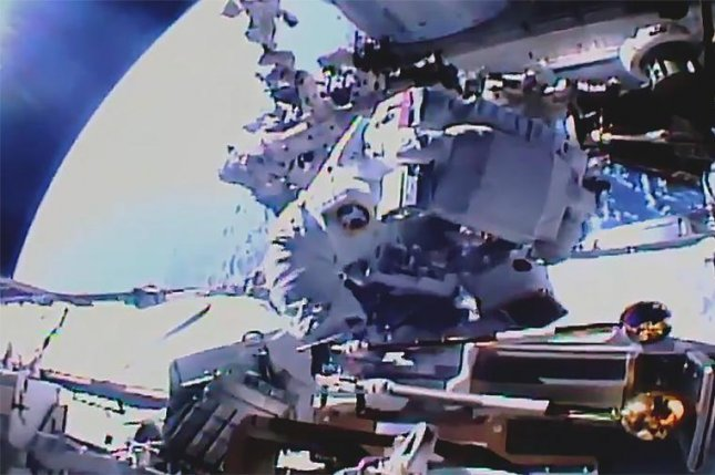 Astronaut Akihiko Hoshide of Japan works on the station's Port-4 truss structure installing a modification kit and preparing it for a future solar array. Photo courtesy NASA TV