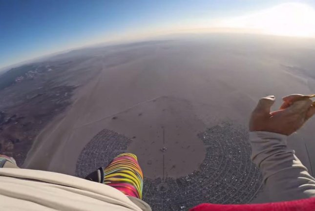 A Burning Man attendee skydives over the festival. Christopher Farro/YouTube video screenshot