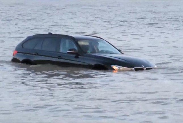 One of three vehicles stolen by high tides during the weekend at England's Brean Beach. Screenshot: Newsflare