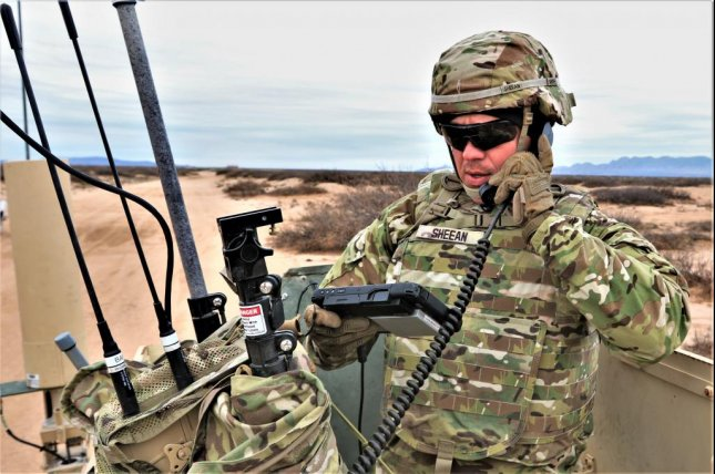 Staff Sgt. Micah Sheean, an electronic warfare specialist, communicates intelligence information from a high mobility multipurpose wheeled vehicle. Photo by Staff Sgt. Felicia Jagdatt/U.S. Army