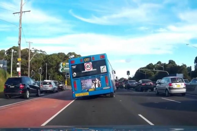 A bus in Sydney leans noticeably to one side. Screenshot: Dash Cam Owners Australia/Facebook video