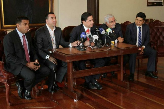 Colombian Interior Minister Juan Fernando Cristo, seen here during a press conference on Wednesday, drafted a proposal that will be introduced to the House of Representatives detailing how FARC can become a political party. Photo courtesy of Juan Fernando Cristo