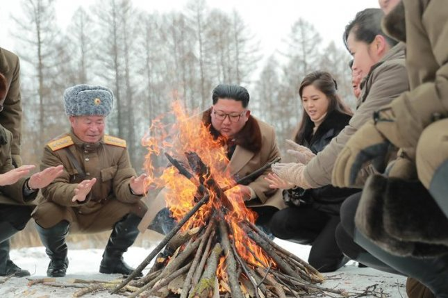 Kim Jong Un walks in forefathers' footsteps in North Korea documentary footage released Thursday of his trip to Mount Paektu in October. File Photo by KCNA