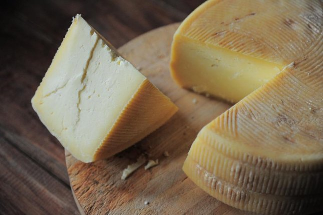 More than two-thirds of people in a recent survey would be willing to try cheese made from real milk proteins produced by microorganisms instead of animals, researchers say. Photo by AlexKlen/Pixabay