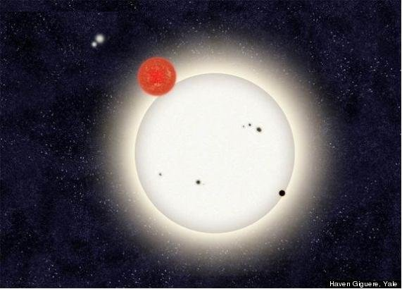 The newly discovered planet PH1 is depicted in this artist's rendition transiting the larger of the two eclipsing stars it orbits. Off in the distance, well beyond the planet orbit, resides a second pair of stars bound to the planetary system. Credit: Haven Giguere/Yale University