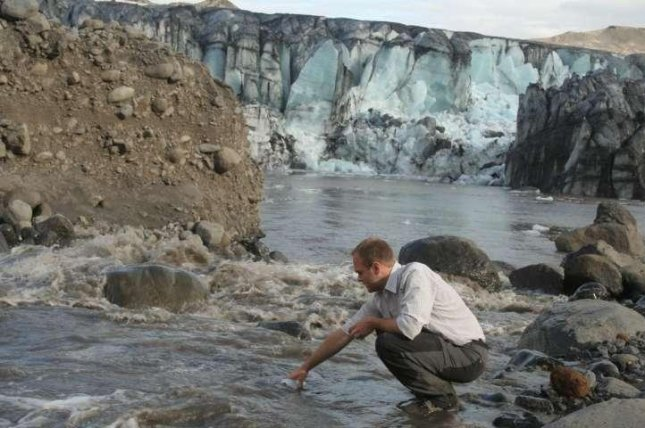 Researcher Peter Wynn is pictured collecting a water sample near the terminus of the Sólheimajökull glacier in Iceland. Photo by University of Lancaster