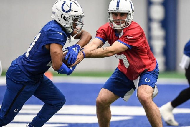 Former Denver Broncos quarterback Chad Kelly (R) has been taking reps as the Indianapolis Colts' fourth-string quarterback this off-season. Photo courtesy of the Indianapolis Colts