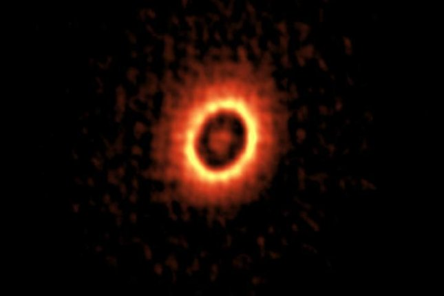 ALMA's images revealed two concentric rings -- where planets may be forming -- surrounding a young, sun-like star. Photo by ALMA (ESO/NAOJ/NRAO) / Kudo et al.