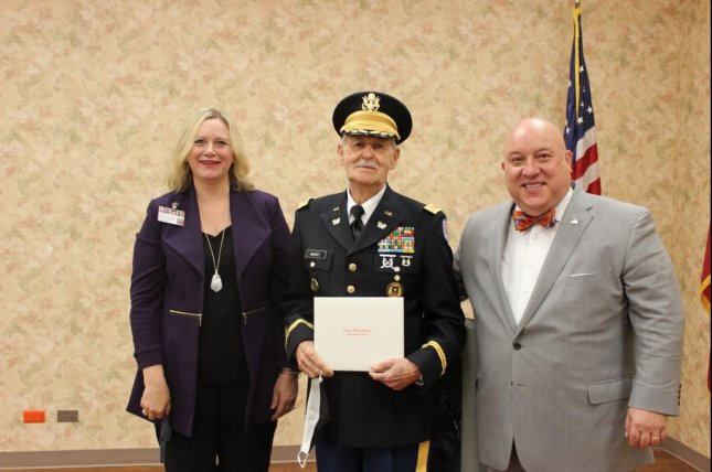 Paul Mackey, 84, who left high school early to serve in the Korean War, was presented with his high school diploma by theTexarkana Independent School District's Board of Trustees. Photo courtesy of theTexarkana Independent School District