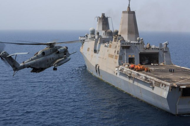 A U.S. Marine Corps CH-53E Super Stallion helicopter prepares to land aboard the amphibious transport dock ship USS the Mesa Verde while underway in the U.S. 5th Fleet area of responsibility, Aug. 4, 2014. U.S. Navy/Manuel A. Estrada