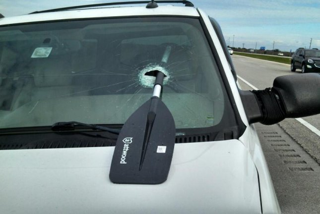 A unsecured oar fell from a motor home and crashed through a Florida woman's windshield. Screenshot: WBBH-TV