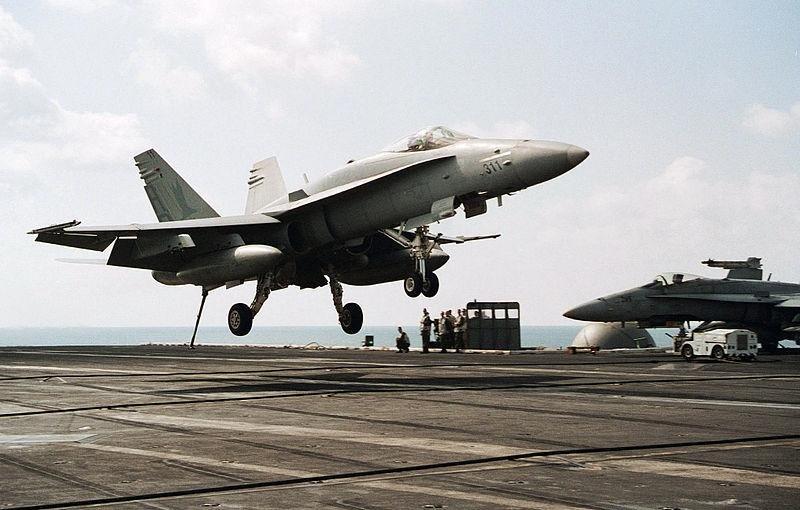 An F/A-18 Hornet lands on the USS Theodore Roosevelt. U.S. Navy photo by Photographer's Mate 3rd Class Luke Williams.