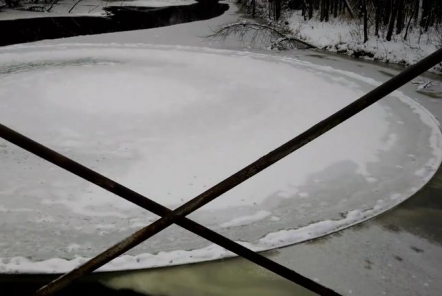 A large disc of ice spins in Michigan's Muskegon River. Screenshot: Weather Channel
