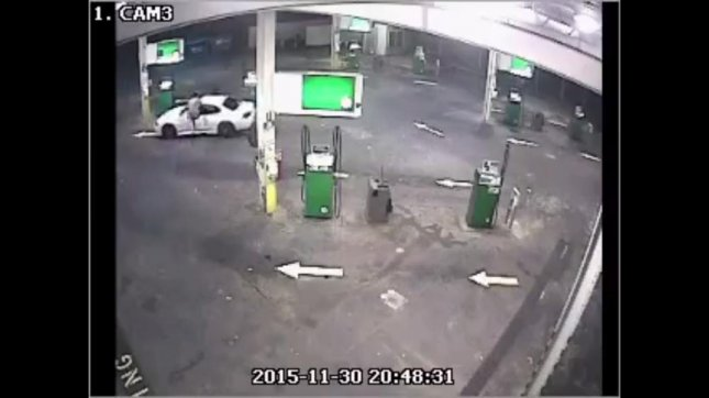 The owner of a car being stolen from a gas station in Malak, Australia, performs a flying kick into the passenger window of the moving vehicle. Northern Territory Police, Fire and Emergency Services/Facebook video screenshot