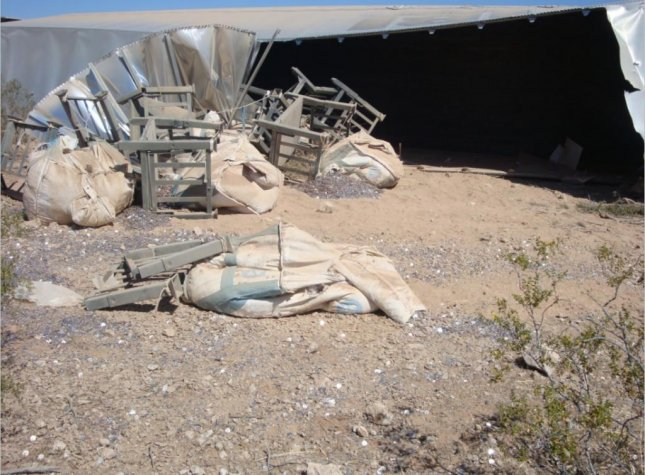 A semi truck struck a guardrail on a Nevada highway and spilled its load of 8 million dimes next to the roadway. Photo courtesy of the Nevada Highway Patrol