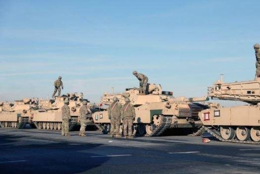 U.S. Army tanks of the 1st Armored Brigade Combat Team, 1st Infantry Division, travel through Antwerp, Belgium. Photo by Sgt. Benjamin Northcutt/U.S. Army/UPI