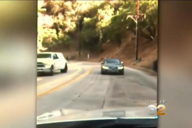 Kevin Zanazanian filmed this motorist driving in reverse on a busy Los Angeles road Thursday. CBS Los Angeles video screenshot