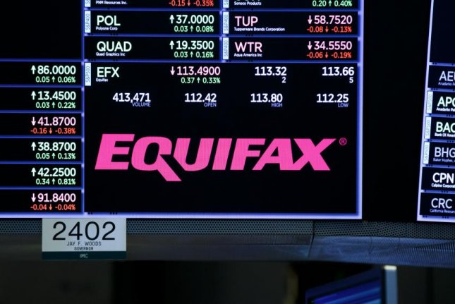 An Equifax logo is displayed at the New York Stock Exchange. Tuesday, the agency announced that its CEO, Rick Smith, will retire effective immediately. Phto by Justin Lane/EPA