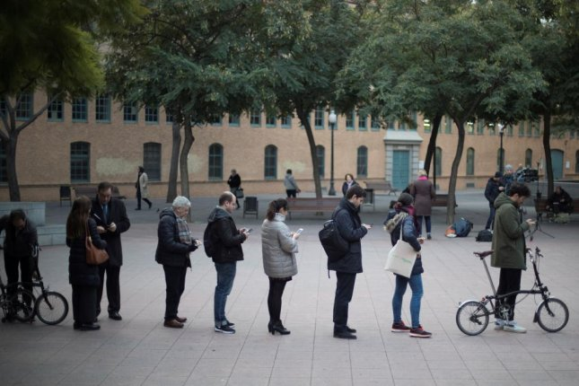 Voters wait in a queue outside a voting station in Barcelona, Spain, on Thursday. Catalan residents will vote for leaders in the region following the ouster of Carles Puigdemont's government in October. Photo by Marta Perez/EPA