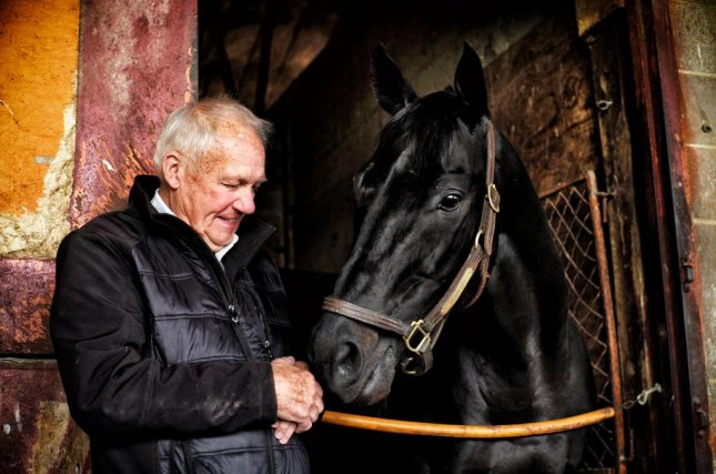 Owner/trainer King Leatherbury with his 10-year-old star, Ben's Cat, who will try this weekend at Pimlico to win the Jim Mc Kay Turf Sprint for the fifth time. Photo by Jon Kral/Pimlico